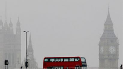 A bus crosses Waterloo bridge in front of the Houses of Parliament during a misty morning in London (REUTERS/Luke MacGregor)