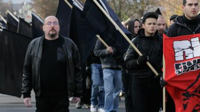 Far-right activist walk through the town of Remagen, some 25 km (15 miles) south of Bonn, November 19, 2011. Reuters / Wolfgang Rattay