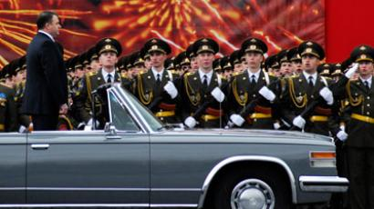 Russian Defence Minister Anatoly Serdyukov rides in a convertible ZiL limousine as he observes troops during a World War Two victory parade in Red Square in Moscow.(REUTERS / Stringer Russia)