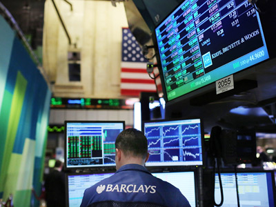 A trader works on the floor of the New York Stock Exchange (AFP Photo / Spencer Platt)
