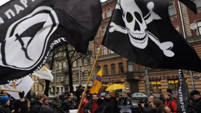 Members and supporters of anti-copyright Pirate Party take part in a rally against what they call the censorship in the Internet in Saint-Petersburg, on November 17, 2012. (AFP Photo/Olga Maltseva)