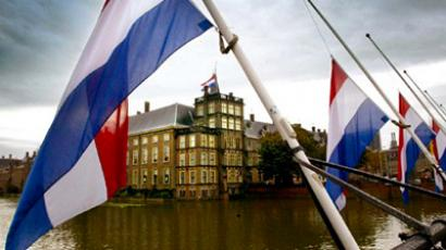 Dutch flags fly at half-mast near the Dutch Parliament building (background) in The Hague, Netherlands (AFP Photo / Getty Images)