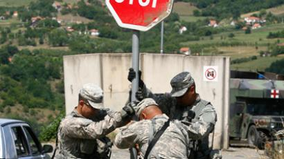 U.S. NATO soldiers repair a road sign near the Serbia-Kosovo border crossing in Jarinje July 28, 2011 (Reuters/Stringer)