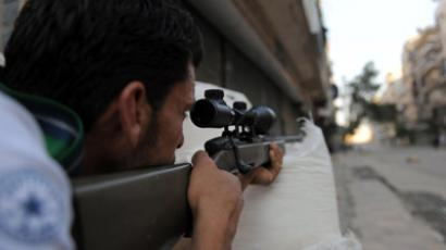 A fighter from the Syrian opposition aims fire during clashes with forces loyal to President Bashar al-Assad, in the center of Syria's restive northern city of Aleppo on July 25, 2012. (AFP Photo/Bulent Kilic)