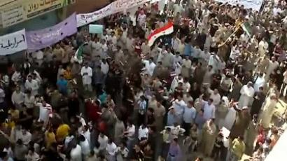 An image grab taken from a video uploaded on YouTube on October 7, 2011 shows people demonstrating in the central city of Hama (AFP Photo / Youtube)