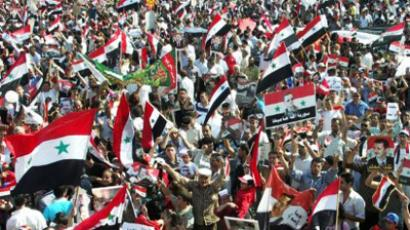 Syria allows political parties