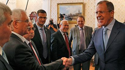 Russia's Foreign Minister Sergey Lavrov (R) meets with Syrian opposition leaders in Moscow July 11, 2012 (Reuters/Sergei Karpukhin)