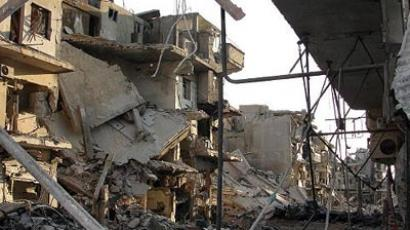 Severely damaged buildings in Homs (AFP Photo)