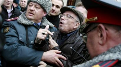 Russian police arrest Russian counter-culture writer and political opposition leader Eduard Limonov at a rally in Moscow on March 31, 2010 (AFP Photo / STR)
