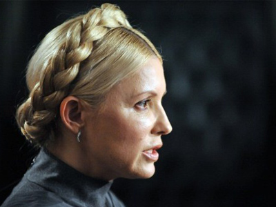 Kiev: Ukraine's former Prime Minister and a leader of the opposition Yulia Tymoshenko speaks to a journalist in her residence in Kiev. (AFP Photo/ Sergei Supinsky)