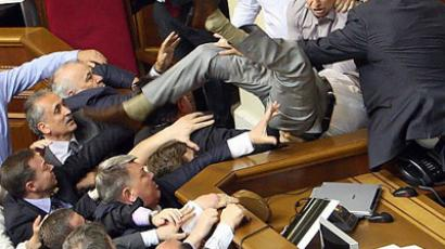 Kiev : Deputies of the Ukrainian opposition fight with deputies of the pro-presidential majority during a session of parliament in Kiev, as opposition parties protest a bill proposed by the ruling party which would make Russian an official state language along with Ukrainian. (AFP Photo/Stringer)