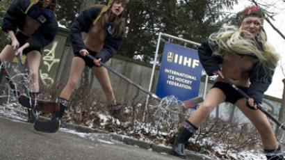 Activists from Ukrainian feminist group FEMEN shout slogans and carry hockey sticks during a topless protest on February 1st, 2012, in Zurich against the Hockey world cup in 2014 in Belarus (AFP Photo / Sebastien Bozon)
