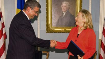 Romanian Foreign Minister Teodor Basconschi (L) and US Secretary of State Hillary Clinton shake hands after signing a Ballistic Missile Defense Agreement between the US and Romania at the US Department of State, September 13, 2011, in Washington, DC. (AFP Photo/Paul J. Richards )