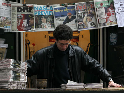 Karim Benkanoun waits for customers at Nick's Newsstand February 26, 2010 in San Francisco, California.(AFP Photo / Justin Sullivan)