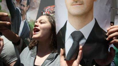 Syrian supporters of President Bashar al-Assad (AFP Photo / Louai Beshara)