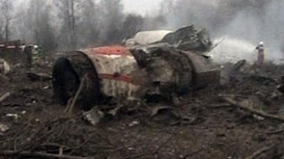 Image from video footage shows firefighters working to extinguish the flames near the wreckage of a Polish government Tupolev Tu-154 aircraft after it crashed near Smolensk airport in western Russia April 10, 2010. (Reuters/TVP via Reuters TV)
