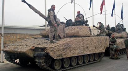 Swedish soldiers with the NATO-led International Security Assistance Force (ISAF) are seen with their tanks in the outskirts of Mazar-i-Sharif on November 3, 2010 (AFP Photo / Kazim Ebrahimkhil)