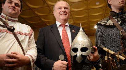"Leader of the Communist Party Gennady Zyuganov, center, seen at the constituent convention of the Russian Creative Movement ""Russky Lad"" (""Russian Concord).(RIA Novosti / Maxim Blinov)"