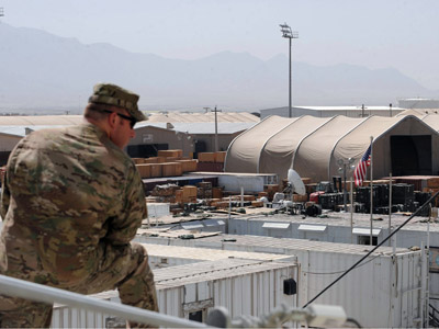 US army soldier stands at the top of a building at the Bagram Airfield, 50 kms north of Kabul.  (AFP Photo/Shah Marai)