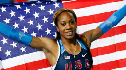 Sanya Richards-Ross of the U.S. holds a national flag as she celebrates her gold medal in the women's 400 metres final during the world indoor athletics championships at the Atakoy Athletics Arena in Istanbul March 10, 2012 (Reuters / Murad Sezer)