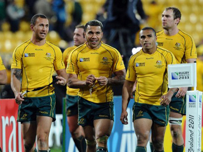 (From L) Australia's Wallabies fly-half Quade Cooper, Australia's Wallabies wing Digby Ioane and Australia's Wallabies scrum-half Will Genia celebrate after the 2011 Rugby World Cup quarter-final match South Africa vs Australia at the Wellington Regional stadium in Wellington on October 9, 2011 (AFP Photo / PHILIPPE LOPEZ)