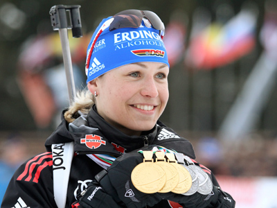 Magdalena Neuner of Germany holds her gold medal as well as other medals won from recent races after winning the women's 4x6 km relay at the IBU Biathlon World Championships in Khanty-Mansiysk, Western Siberia, March 13 2011 (Reuters / Alexander Demianchuk)