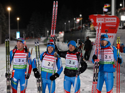 Russia's Alexey Volkov (L-R), Evgeny Ustyugov, Evgeniy Garanichev and Anton Shipulin pose after the 4x7.5 km men's relay competition at the Biathlon World Cup in the eastern German ski resort of Oberhof January 5, 2012 (Reuters / Tobias Schwarz)