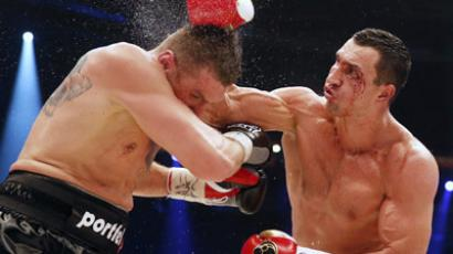 Ukrainian heavyweight boxing world champion Vladimir Klitschko lands a blow on Polish challenger Mariusz Wach (Reuters/Morris MacMatzen)