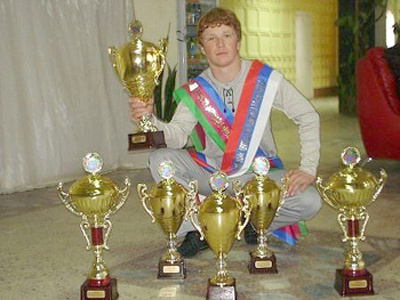 Evgeny Smirnov with his many trophies (Image from Evgeny Smirnov's page at Odnoklassniki.ru)