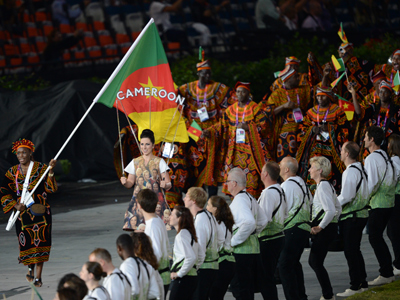 Cameroon's flagbearer Annabel Laure Ali carries the flag as he leads his delegation during the opening ceremony of the London 2012 Olympic Games (AFP Photo / Christophe Simon)