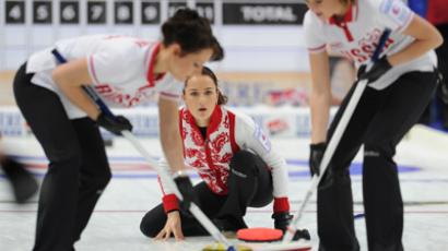 Russian women's team players Ekaterina Galkina, Anna Sidorova and Margarita Fomina (L-R) in the European Curling Championships (RIA Novosti / Alexey Philippov)