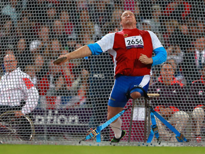 Russian wheelchair athlete Alexei Ashapatov during the discus throw event at the 2012 London Paralympics. He won the gold medal and set a new world record. (RIA Novosti/Anton Denisov)