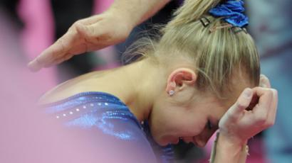 Russian gymnast Viktoria Komova reacts after losing to Gabby Douglas in the individual all-around event at the London 2012 Olympics (RIA Novosti / Syisoev)