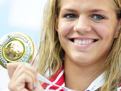 Russia's gold medalist Yuliya Efimova poses on the podium during the medal ceremony of the women's 100m breaststroke at the European Swimming Championships in Budapest on August 11, 2010