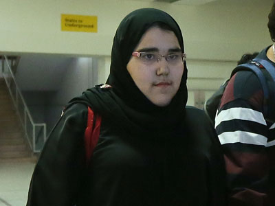 Female Saudi Judo athlete Wodjan Ali Seraj Abdulrahim Shahrkhani arrives at Heathrow airport in preparation for the 2012 London Olympic Games. (AFP Photo / Marwan Naamani)