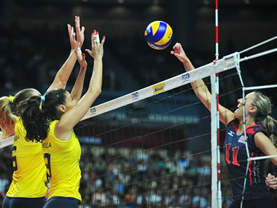 Team USA's Jordan Larson punches the ball over the net (Image from www.fivb.org)