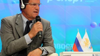 Italian football expert Fabio Capello attending a press conference at the RIA Novosti agency, where it was announced about his signing a two-year contract with the Russian Football Union on becoming the new chief coach of the Russian national football team (RIA Novosti / Anton Denisov)