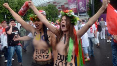 Members of Ukrainian feminist group Femen protests against prostitution near the National Stadium in Warsaw on June 8, 2012 (AFP Photo / Janek Skarzynski)