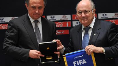 Russian Minister for Sport, Vitaly Mutko, (L) and FIFA President Joseph Blatter give a press briefing after Russian cities to host 2018 FIFA World Cup were announced. (RIA Novosti/Ramil Sitdikov)