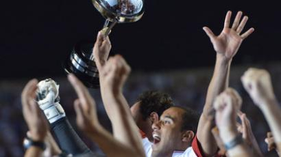 Lucas of Brazil's Sao Paulo celebrates with the trophy for the victory of their Copa Sudamericana football final match against Argentine's Tigre at Morumbi stadium in Sao Paulo, Brazil, on December 12, 2012. (AFP Photo/Yasuyoshi Chiba)