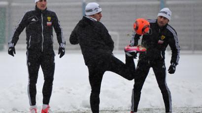 Form left: FC Anzhi players Rasim Tagirbekov, Serder Serderov and Kamil Agalarov during a training session at the team's base in the village of Kratovo. (RIA Novosti/Ramil Sitdikov)
