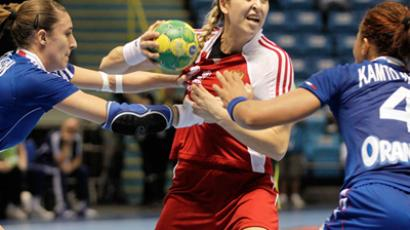 Russia's Olga Levina (C) is challenged by France's Camille Ayglon (L) and Nina Kamto during their Women's World Handball Championship quarterfinal match in Sao Paulo December 14, 2011. (REUTERS/Ricardo Moraes)