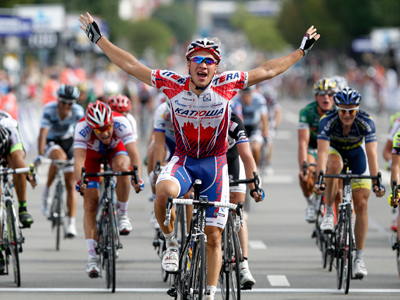 Katusha Team rider Denis Galimzyanov of Russia raises his arms as he wins the Paris-Brussels cycling race in Brussels September 10, 2011 (Reuters/Francois Lenoir)