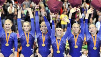 Russian Gold medallists celebrate on the podium at the end of the Women's Team Final at the 42nd Artistic Gymnnastics World Championships on October 20, 2010 in Rotterdam (AFP Photo / Boris Horvat)