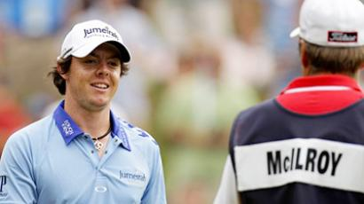 Rory McIlroy of Northern Ireland (L) (AFP Photo / Getty Images)