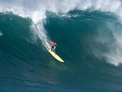 Professional surfer Garrett McNamara drops in on a large wave (Reuters/Hugh Gentry)