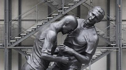 A statue depicting former French national soccer team player Zinedine Zidane's (L) head-butt on Italian defender Marco Materazzi during the 2006 final of the soccer World Cup. (Reuters / Christian Hartmann)