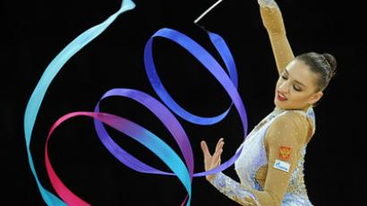 Yevgeniya Kanaeva, a gold medalist, performing during an individual ribbon event at the Rhythmic Gymnastics World Championships, Montpellier, France. (RIA Novosti/Grigory Sysoev)