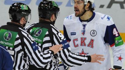 From right: SKA player Yevgeny Artyukhin arguing with judges Ivan Sazonov and Alexander Sadovnikov during the Kontinental Hockey League's Gagarin Cup semifinal match HC Dynamo Moscow vs. HC SKA St. Petersburg (RIA Novosti / Ramil Sitdikov)