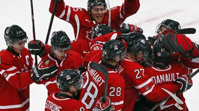 Canada's players celebrate defeating Team USA during their preliminary round game at the 2013 IIHF U20 World Junior Hockey Championship in Ufa, December 30, 2012. (Reuters/Mark Blinch)